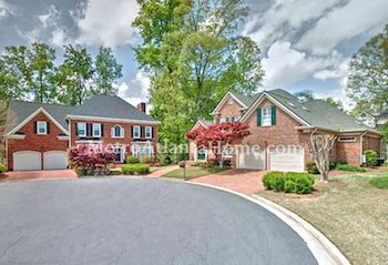 Two-story brick homes located in Dunwoody's Brooke Farm neighborhood.