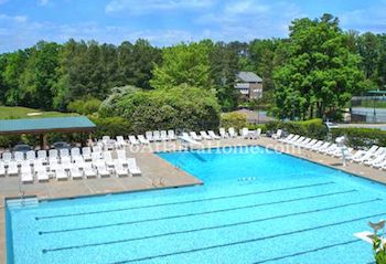 The large pool and neighborhood amenities overlooking the golf course at Brookfield Country Club.