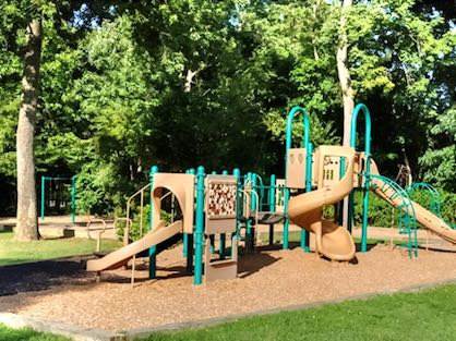 A small playground with slides and climbing bars.