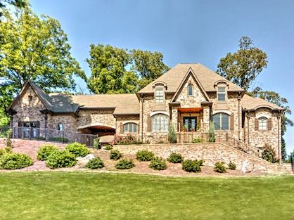 Large brick home for sale in an upscale Buckhead subdivision.