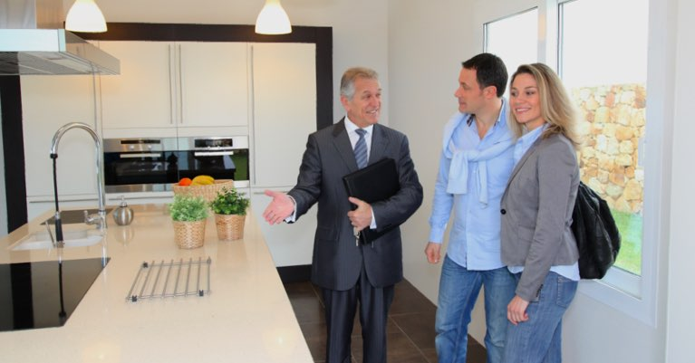 Home buyers in kitchen with their REALTOR®.