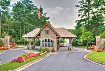 The guarded entry gate to the Country Club of the South.