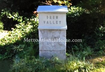 A stone neighborhood entry sign for Drew Valley.