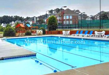 The neighborhood pool and tennis courts at Evergreen in Lilburn, GA.