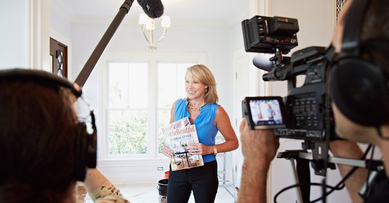 A woman being filmed for a popular home buying reality television show.