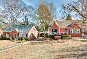 Two smaller brick homes in Decatur's Forrest Hills neighborhood.