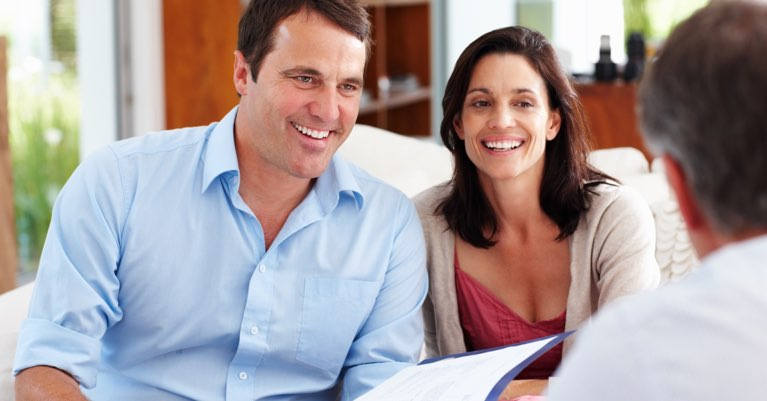 A happy couple meeting with their REALTOR®.