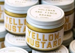 Holeman & Finch brand yellow mustard jars.