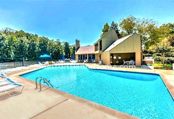 The neighborhood pool and community clubhouse at Loch Highland in Roswell, GA.