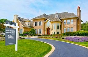 Metro Atlanta luxury property with BHGRE Distinctive Collection yard sign and SOLD sign rider.
