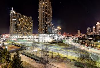 Atlantic Station and Midtown Atlanta skyline at night.