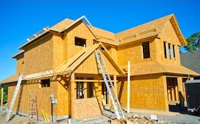 Two-story Metro Atlanta home being built and listed for sale by a new home sales specialist.