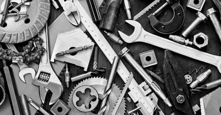 A black & white photo of various tools for new homeowners.
