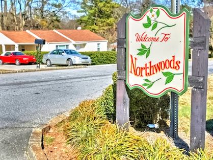 Northwoods neighborhood entrance welcome sign.