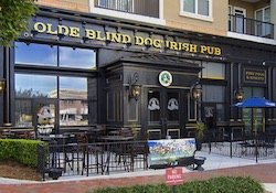 Outdoor dining area and entrance to Old Blind Dog at Town Brookhaven.