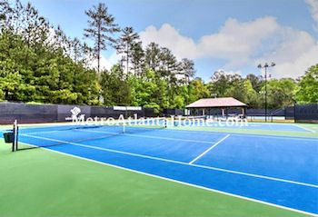 The Park Forest tennis courts and community amenities.