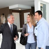 Young couple touring a home with their REALTOR®.