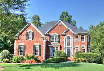 A brick two-story traditional style home located in the River Plantation neighborhood.