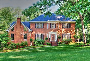 A two-story traditional style brick home in the Rivercliff subdivision.