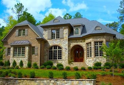 A brick and stone luxury home for sale in the city of Roswell.
