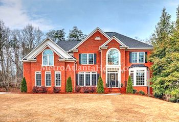 A two-story brick home located in the Springside At Neely neighborhood.