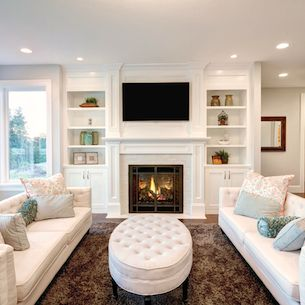Staged living room with two sofas and fireplace.