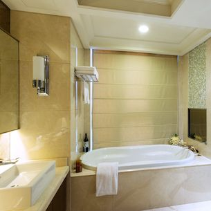 Staged bathroom with jetted tub and decorative accents.