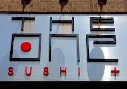 Sign and logo for The One Sushi + Restaurant in Brookhaven.