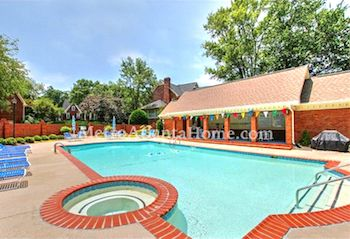 The community pool and clubhouse at The Woodlands in Dunwoody, GA.