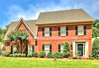 A two-story brick home for sale in The Woodlands.
