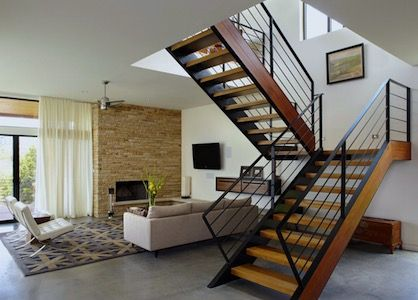 View of the living room in a modern Townhome with staircase leading to second level.