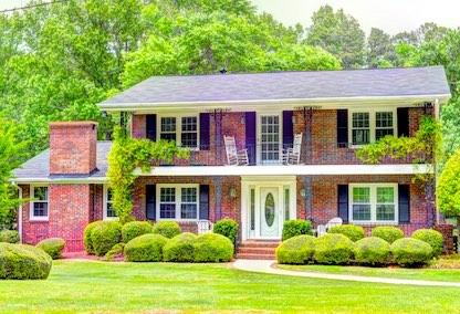 A two-story lakefront home for sale in Tucker, GA.