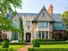 Huge Tudor style home with multiple fireplaces and exquisite landscaping.