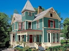 Gorgeous Victorian style home with colorful exterior and wraparound porch.