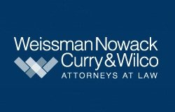 The Weissman, Nowack, Curry & Wilco logo.