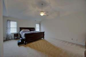 Expansive master bedroom with sitting area and en suite bath.