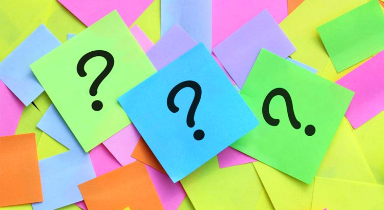 Sticky post-it notes piled on top of each other with question marks on them Coldwell Banker Paradise