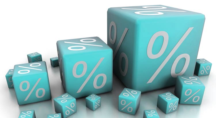 Pile of blue dice with percent symbols on them Coldwell Banker Paradise