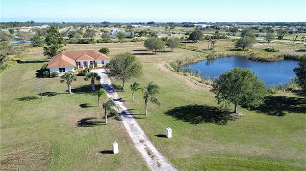 Aerial view of yard and house