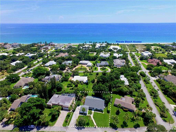 Aerial view of yard and house and beach