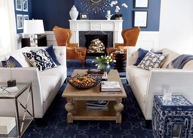Blue living room with various couches and chairs - Coldwell Banker Paradise