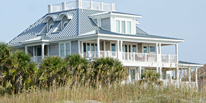 Blue house on the beach - Coldwell Banker Paradise