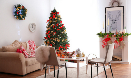 Christmas tree in new home with fireplace - Coldwell Banker Paradise