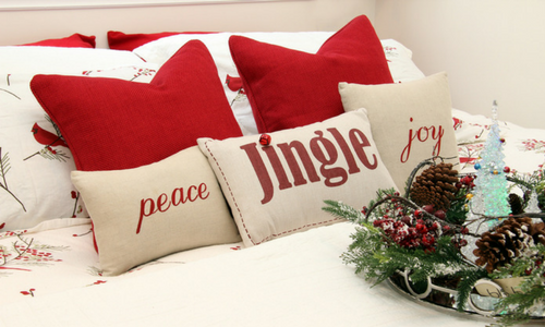 Holiday bed with holiday themed pillows - Coldwell Banker Paradise