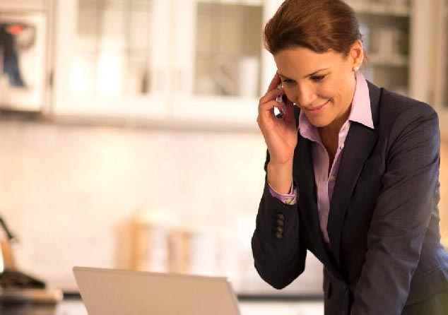 Professional woman on the phone, Laptop or iPad. Coldwell banker Paradise