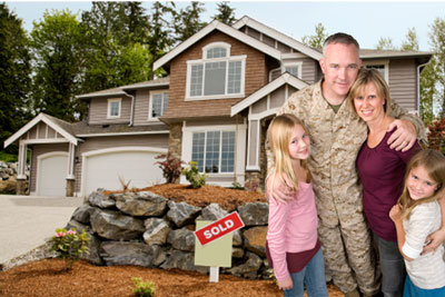 Military Family in Front of New Home