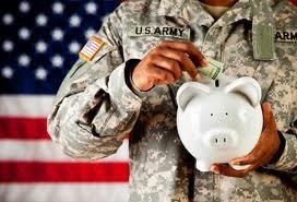 Service Member Putting Money in Piggy Bank