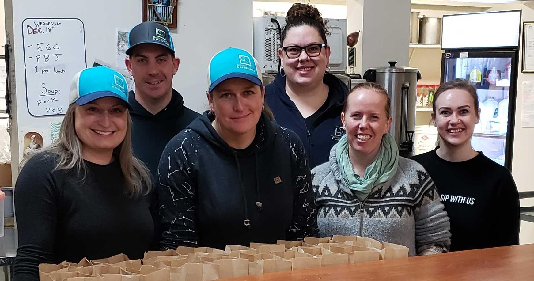 The Dawn Walton & Associates Team volunteering for 7-10 Breakfast Club
