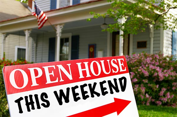 Blue House with open house sign out front