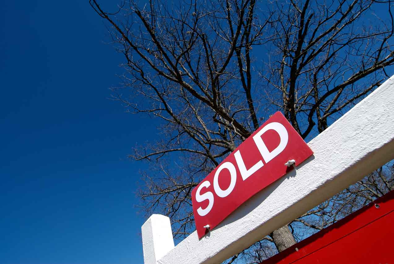 Picture of a sold sign in front of a house